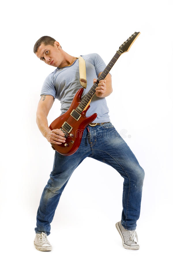 Young musician with guitar. Cool young musician with guitar isolated on white background stock photography