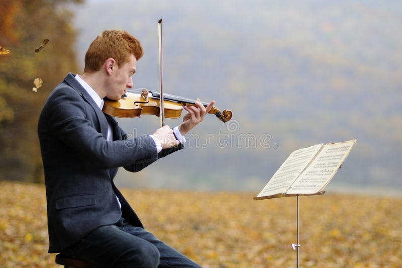 Young musician performing stock images