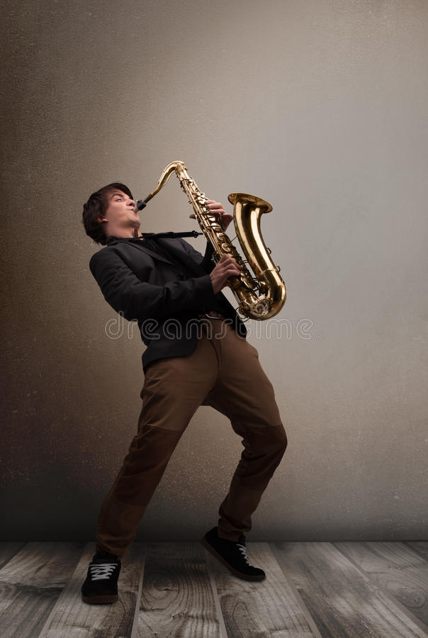 Young musician playing on saxophone royalty free stock image