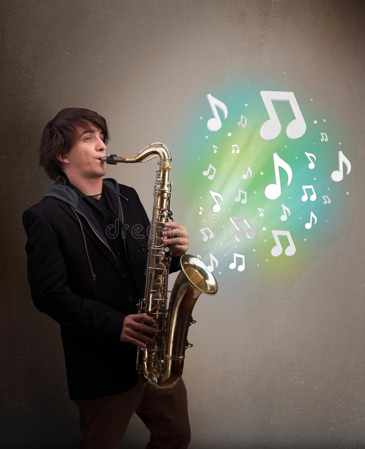 Young musician playing on saxophone while musical notes exploding. Attractive young musician playing on saxophone while musical notes exploding royalty free stock photography