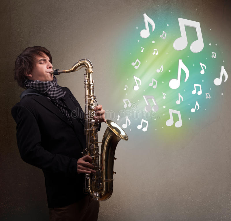 Young musician playing on saxophone while musical notes exploding royalty free stock images