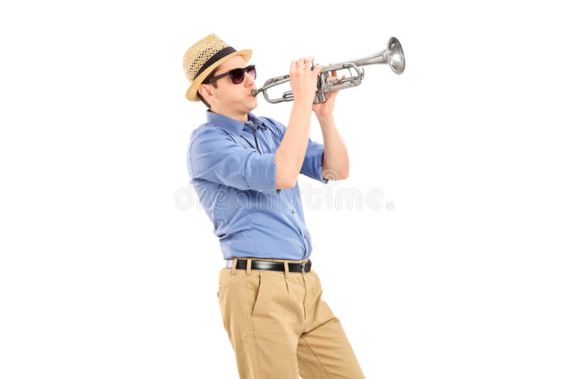 Young musician playing a trumpet. Isolated on white background royalty free stock images