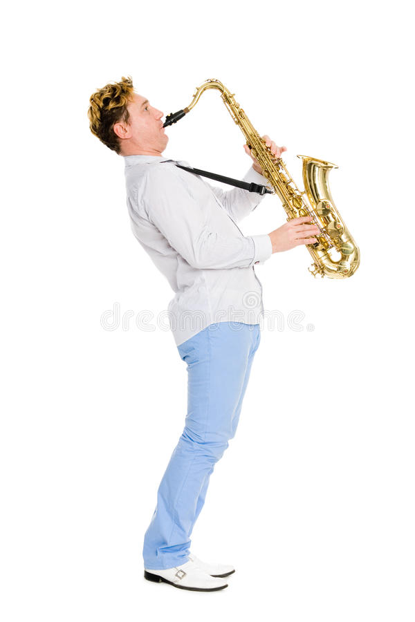 Young musician plays the saxophone. On white royalty free stock image