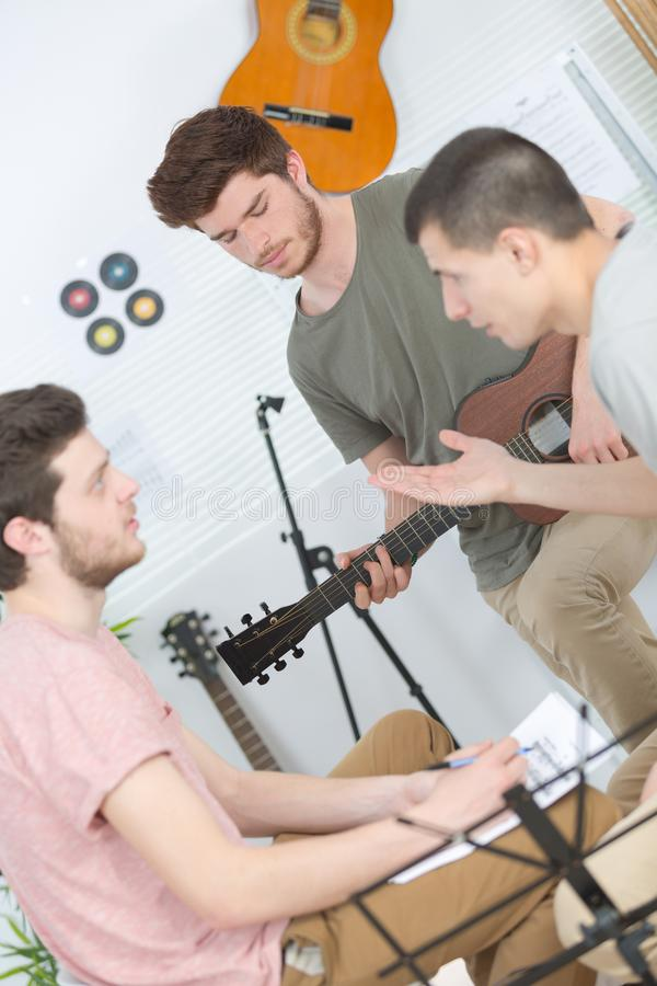 Young musicians composing and rehearsing stock images