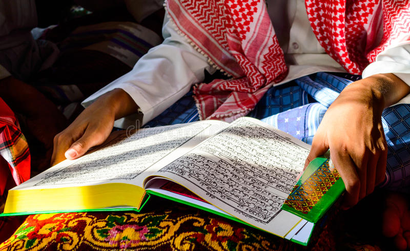 A Young Muslim Boy reading. royalty free stock photos