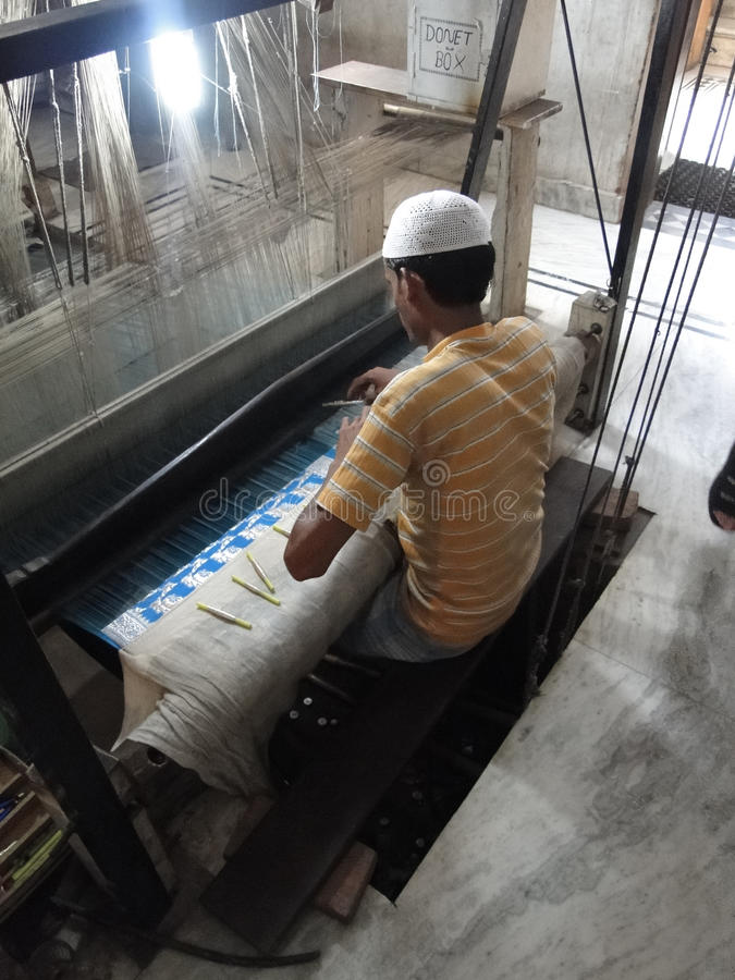 Download Young Muslim Man Runs A Loom To Weave Silk Brocade Editorial Stock Image - Image of cloth, ethnic: 17420264