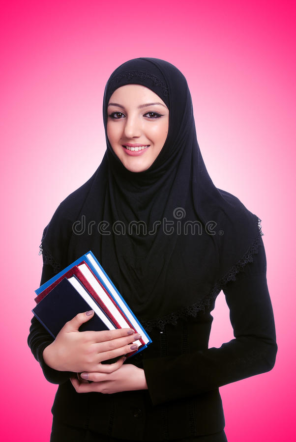 The young muslim woman with book on white. Young muslim woman with book on white royalty free stock photos