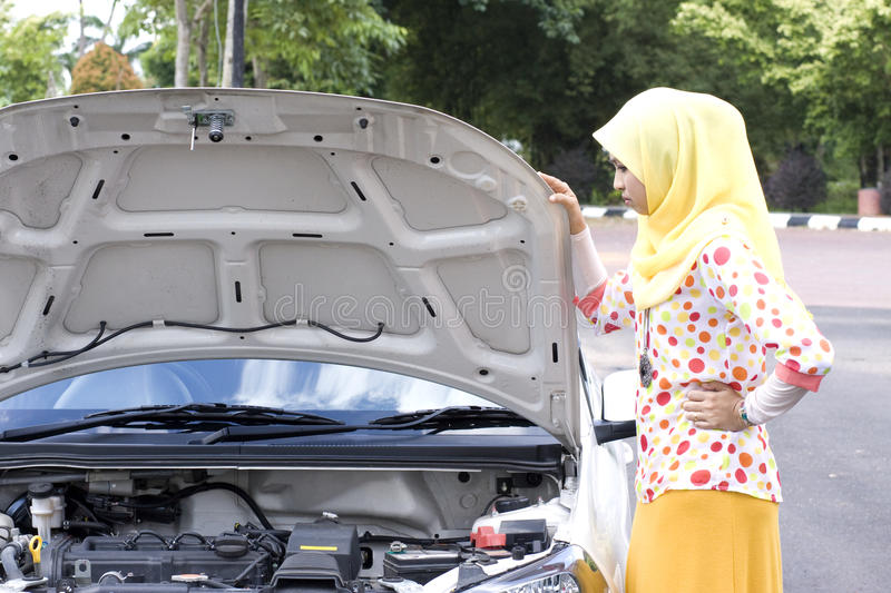 Young muslim woman checking engine stock photos