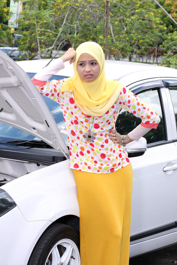Young muslim woman checking engine stock image