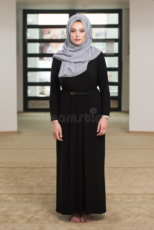 Young Muslim Woman Praying In Mosque royalty free stock photography