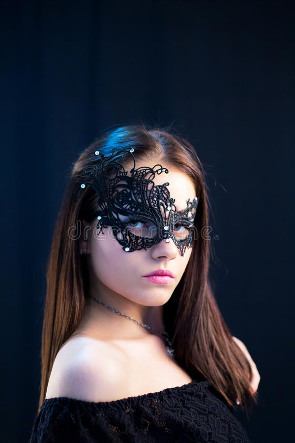 Young Mystic woman posing in mask royalty free stock photography