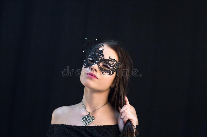 Young Mystic woman posing in mask stock photography