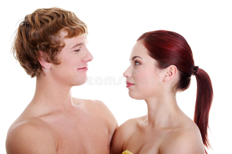 Young naked couple looking at each other. royalty free stock photography