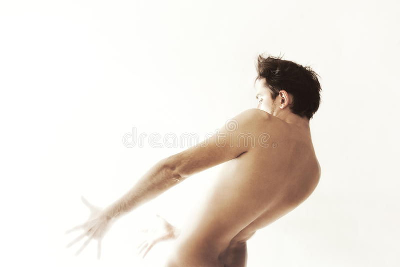 Young naked dancing man royalty free stock image