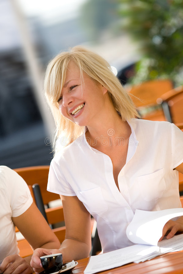Free Young Natural Smiling Blonde Drinking Coffee Royalty Free Stock Image - 6942556