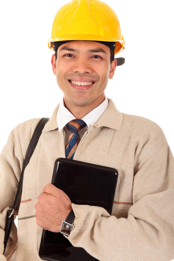 Young Nepalese engineer. Young successful Nepalese engineer, architect with safety helmet and briefcase holding a laptop. Studio shot. White background royalty free stock image
