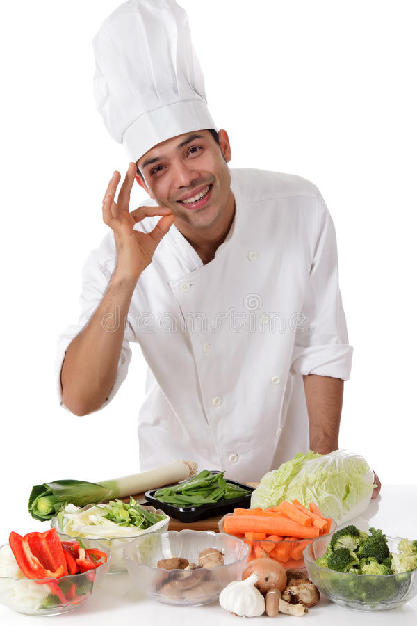 Young nepalese man chef, fresh vegetables stock photography