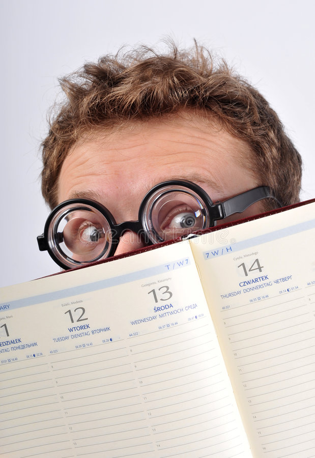 Download Young Nerd Hiding Behind Agenda Stock Image - Image of happy, finger: 7759725