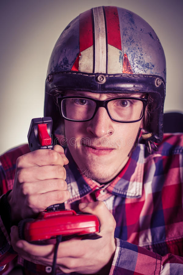 Young nerd playing video games on retro joystick. Vertical image royalty free stock photography