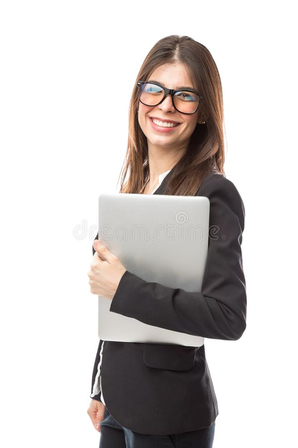 Nerdy woman with a laptop stock image