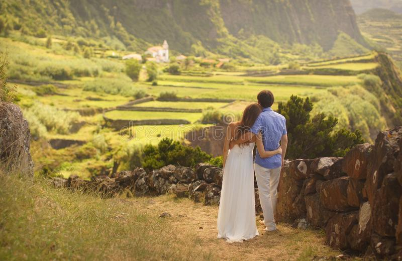Young newly wedded hugging couple in honneymoon on Flores island, Azores royalty free stock photo