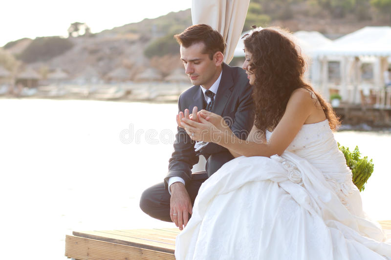 Young newlyweds joined hands royalty free stock images