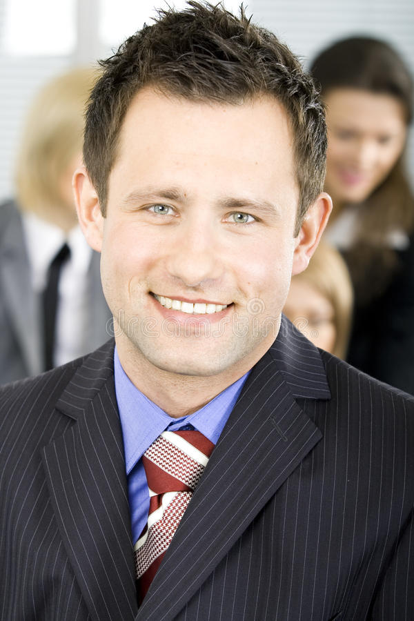 Young handsome succesful businessman smiling royalty free stock image