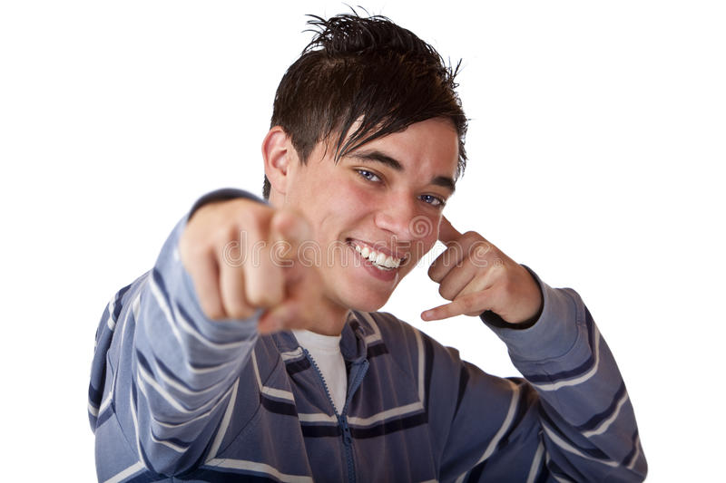 Young And Nice Teenager Points With Finger Stock Images