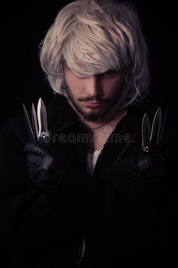 young ninja showing blades royalty free stock photos