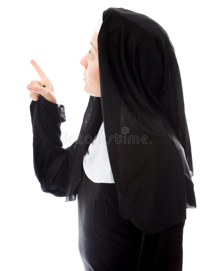 Young Nun Thinking And Pointing Up Stock Photo