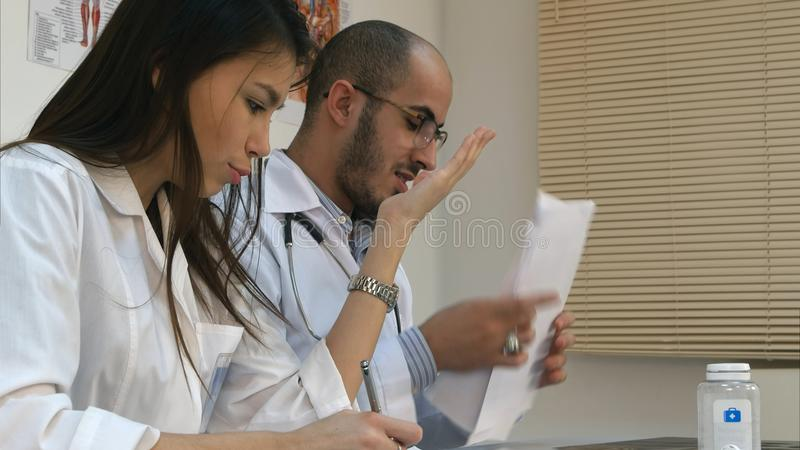Young nurse and male doctor having an argument in the office stock images