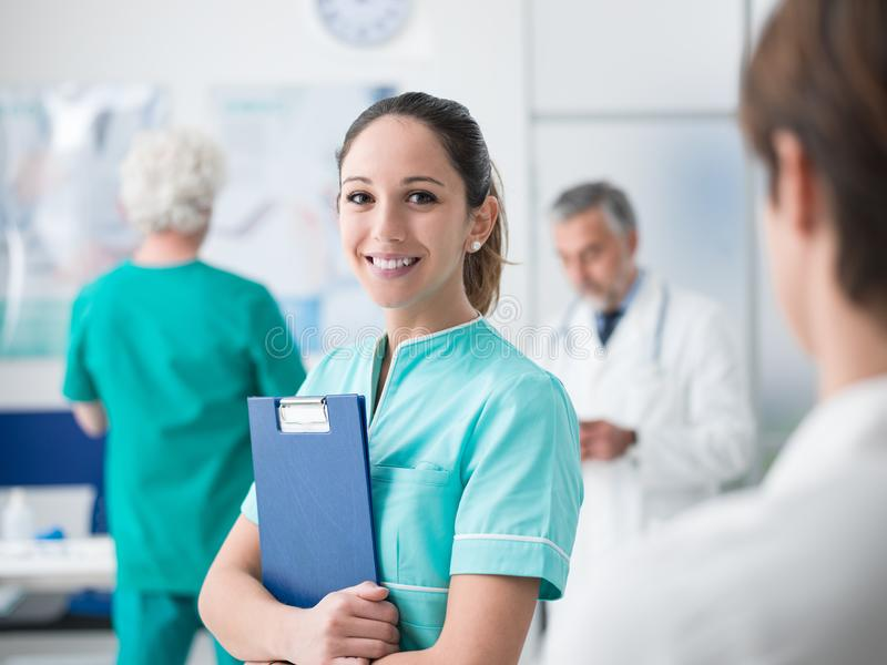 Young nurse working at the hospital stock image
