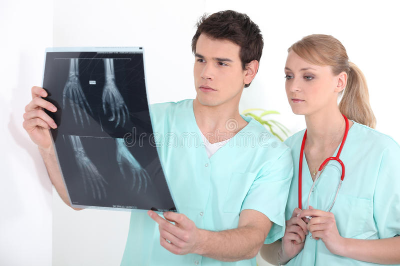 Young nurses looking at an x-ray royalty free stock photography