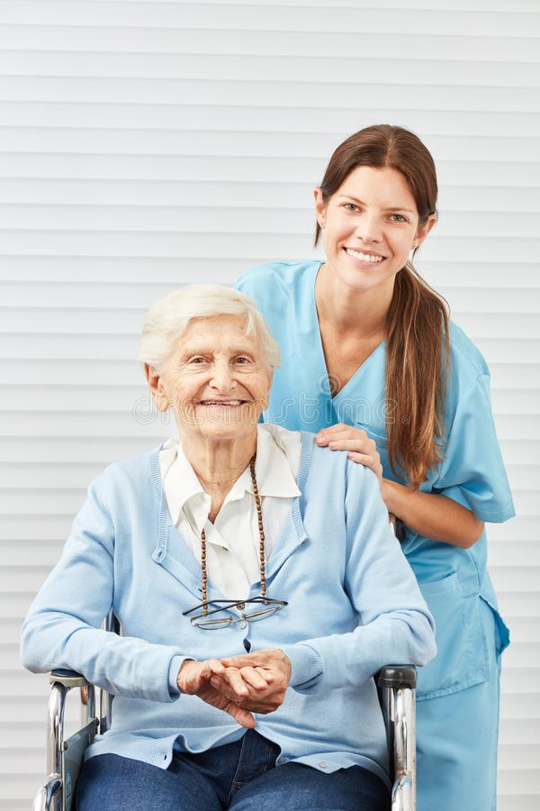 Young nurse and smiling senior citizen royalty free stock images