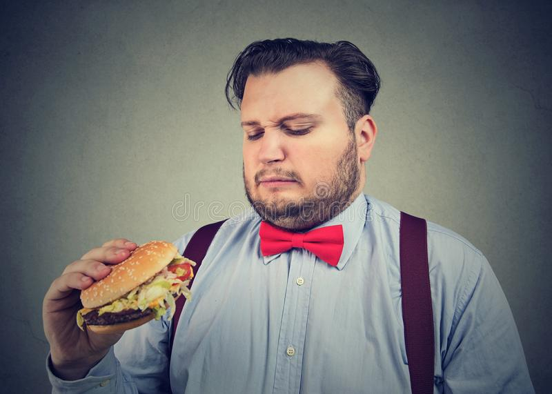 Man unhappy with burger quality royalty free stock photography
