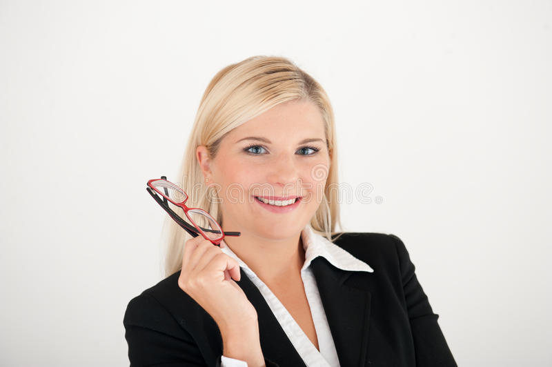 Young office business woman with red glasses. In black suit. gray background stock photography