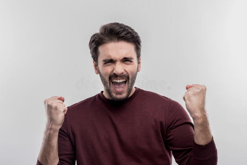 Young office manager feeling very happy after receiving promotion. Finally promotion. Young office manager feeling very happy after receiving promotion on image stock images