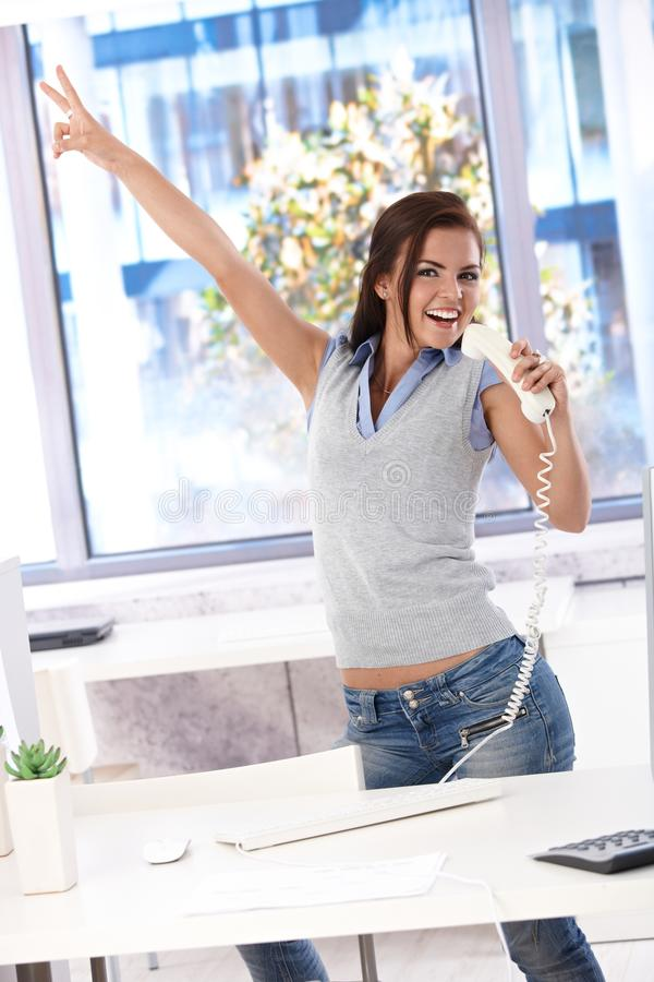 Download Young Office Worker Having Fun In Office Stock Image - Image of cheerful, joyful: 21345051