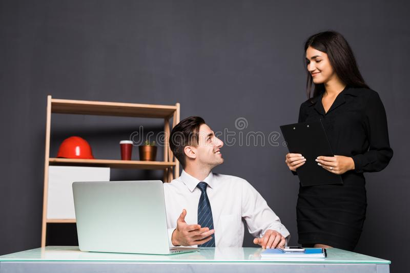 Young office workers in front of desktop computer in office stock images
