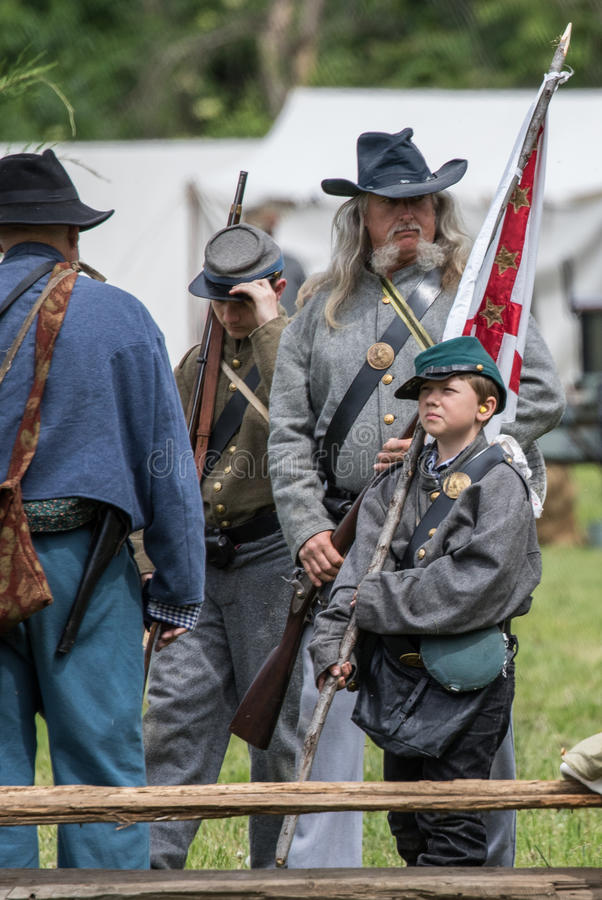 Young and Old Defend the South. Civil War era soldiers and at the Dog Island reenactment in Red Bluff, California royalty free stock photo