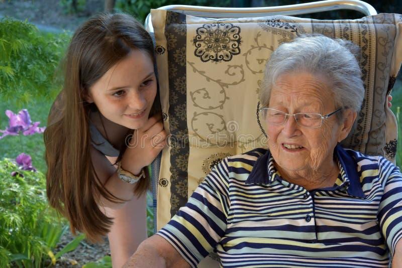 Me and grandma, girl surprises her great-grandma stock image