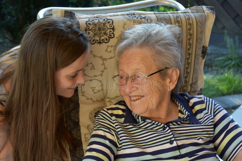 Me and grandma, girl surprises her great-grandma royalty free stock photos