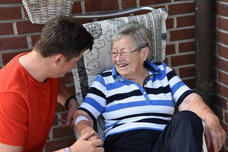 Me and grandma, boy takes care of his great-grandma stock photography