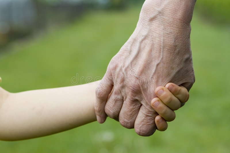 Young and old hands. Child with grandmother