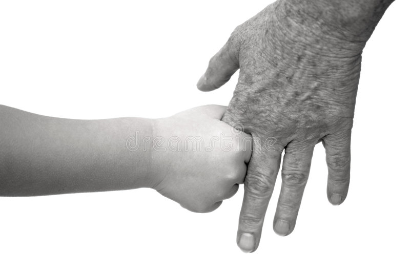 Young and old holding hands royalty free stock photography