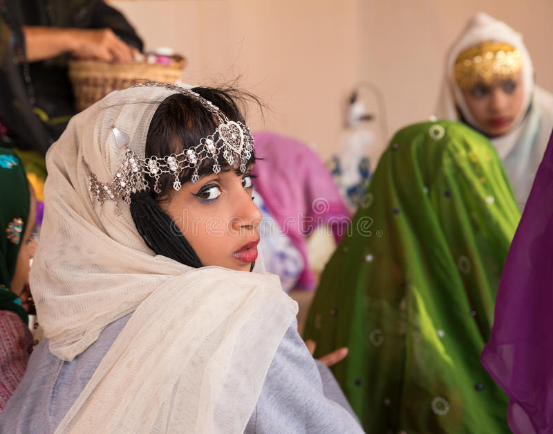 Young Omani girl during a ritual. stock images