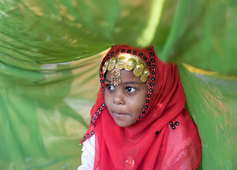 Young Omani girl during a ritual. royalty free stock image