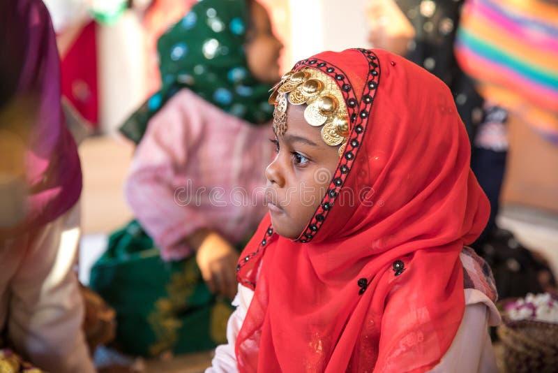 Young Omani girl during a ritual. royalty free stock photos