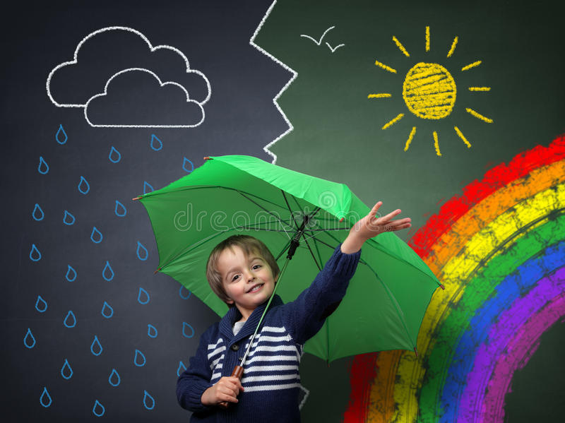 Young optimist a change in the weather stock image