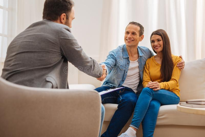Young optimistic couple satisfied with therapy royalty free stock photography